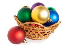 Christmas balls in basket. Varicoloured christmas balls on white background Stock Photo