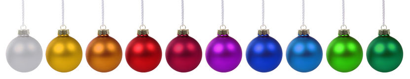 Christmas balls baubles colorful in a row isolated on white Stock Image