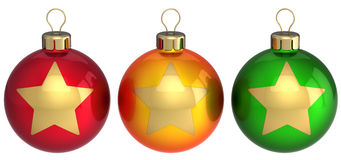 Christmas balls (baubles) multicolored. Christmas balls baubles (red, orange, green) with golden star shapes on them. Beautiful modern Happy New Year decoration Royalty Free Stock Photos