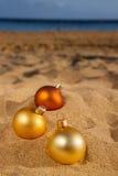 Christmas balls  on beach Stock Photos