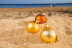 Christmas balls  on beach Royalty Free Stock Images