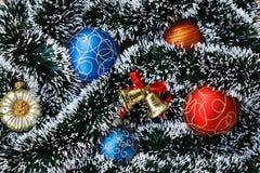 Christmas balls, bell and garland. Stock Photography