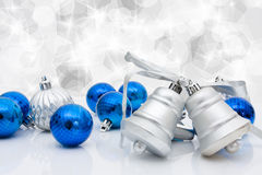 Christmas Balls and Bells. Blue christmas balls and bells on a sparkle background, christmas time Royalty Free Stock Photos