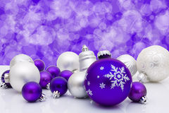 Christmas Balls and Bells. Blue christmas balls and bells on a blue background, christmas time royalty free stock photography