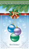 Christmas balls and bells.   Christmas balls and bells under the branches of spruce Stock Photography