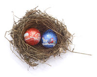 Christmas balls in a bird's nest. Isolated om white Royalty Free Stock Photos