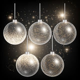 Christmas balls on a black background with gold glitter Stock Photo