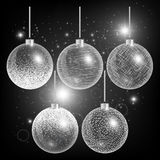 Christmas balls on a black background with silver decoration Stock Images