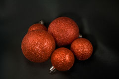 Christmas balls on black satin Stock Photos