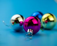 Christmas balls on a blue background. Close-up. royalty free stock image