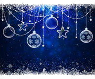 Christmas balls on blue background with snowflakes Royalty Free Stock Photo