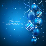 Christmas balls on blue background royalty free stock photography