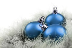Christmas balls in in blue  on feathers Stock Image