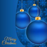 Christmas balls and blue snowflake background. Christmas balls andblue background with place for text Royalty Free Stock Images