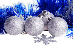 Christmas balls and blue tinsel Stock Images