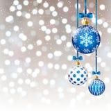 Christmas balls on bokeh background. Blue Christmas balls on silver bokeh background Royalty Free Stock Photo