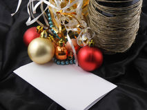 Christmas balls, bottle champagne wine, blank invitation paper Royalty Free Stock Image