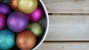 Christmas balls. In a bowl on a wooden table Royalty Free Stock Image