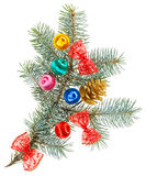 Christmas balls, bows and cone on spruce Stock Photo