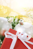 Christmas balls and box Royalty Free Stock Photos