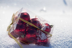 Christmas balls in box on fresh  snow Royalty Free Stock Images