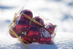 Christmas balls in box on fresh  snow Royalty Free Stock Photography