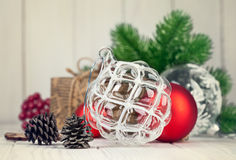 Christmas balls with branch fir and pinecone on wooden board Stock Images