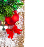 Christmas balls with branch firtree on white snow Royalty Free Stock Images