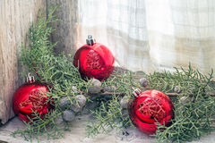 Christmas balls. And branch of juniper in a window sill Stock Photo