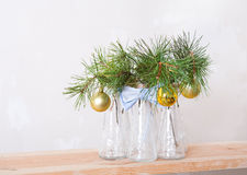 Christmas balls on a branch of tree in glass vases Stock Photos