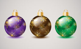 Christmas balls. Bright Christmas balls with gold snowflakes Stock Photography