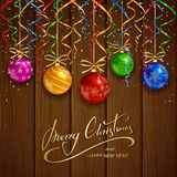 Christmas balls on brown wooden background Royalty Free Stock Photo