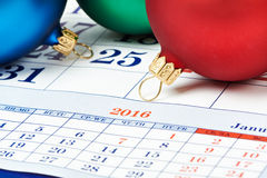 Christmas balls on calendar Royalty Free Stock Image