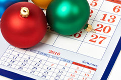 Christmas balls on calendar Royalty Free Stock Photos