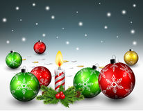 Christmas balls and candle light background Stock Photos