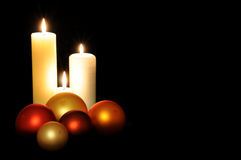 Christmas balls and candles Royalty Free Stock Photography