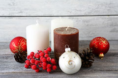 Christmas balls with candles on the boards Royalty Free Stock Photo