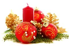 Christmas balls, candles and pine cones. Stock Photography