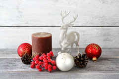 Christmas balls, candles with pine cones and a deer Royalty Free Stock Image