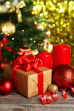 Christmas balls and candles on wooden background Royalty Free Stock Images