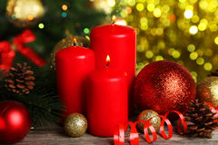 Christmas balls and candles on wooden background Stock Photos