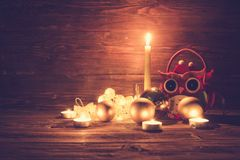 Christmas balls with candles and christmas on wooden table royalty free stock image