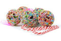 Christmas balls and candy canes Stock Images
