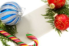 Christmas balls, candy and cards. Stock Image