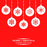 Christmas balls card on red background Stock Photography