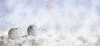Christmas balls on Christmas snowy bokeh background stock photography