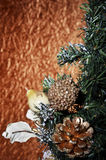 Christmas balls and Christmas tree on a gold background Stockbild