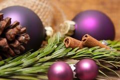 Christmas balls and cinnamon Stock Photo