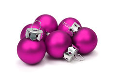 Christmas balls (clipping path included). Pink christmas balls over white background with clipping path Royalty Free Stock Images