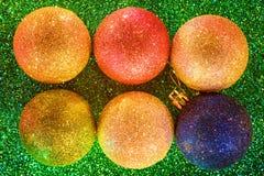 Christmas balls close up on green royalty free stock photos